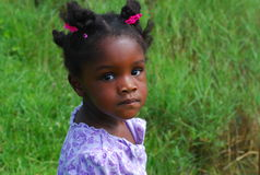 Pretty Black Girl. This young girl is in a field on a hot day, her cheeks are flush Stock Photography