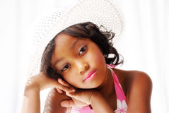 Pretty black girl. Portrait of pretty black girl wearing fashionable sun hat Royalty Free Stock Photos