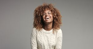 Pretty black girl with big hair posing video. Laugh alot Royalty Free Stock Photos