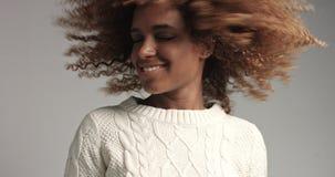 Pretty black girl with big hair posing video Stock Photos