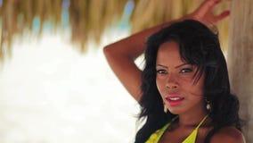 Pretty black girl in yellow bikini stock video