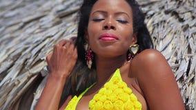 Pretty black girl in yellow bikini stock video footage