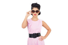Pretty black hair model wearing sunglasses. On white background Stock Images