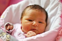 Pretty black hair newborn baby girl stock photo