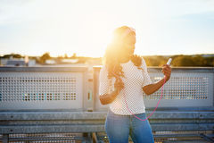 Pretty black lady listening to music Royalty Free Stock Photography