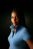 Pretty black teenage girl with blue shirt Royalty Free Stock Photos