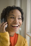 Pretty black woman on cell phone royalty free stock image