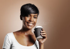 Pretty black woman drinking coffee royalty free stock photography