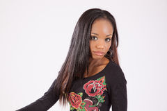 Pretty black woman in flowered blouse Stock Photo