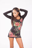 Pretty black woman in flowered blouse standing Royalty Free Stock Photo