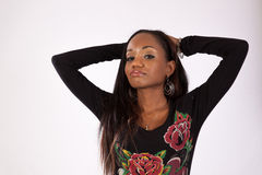 Pretty black woman in flowered blouse standing Royalty Free Stock Images
