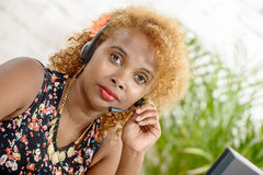 A pretty black woman with headset Stock Images