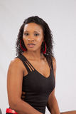 Pretty Black woman in lblack blouse Stock Image