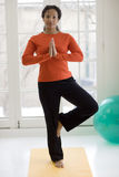 Pretty black woman practicing yoga Royalty Free Stock Photo