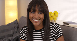 Pretty black woman smiling in striped shirt Royalty Free Stock Photos