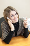 Pretty bland hair woman calling with two mobiles Royalty Free Stock Photos