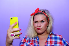 Pretty blog girl wink during selfie with smartphone Royalty Free Stock Photo