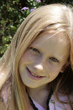 Pretty blond. A pretty white caucasian child playing in the sun Royalty Free Stock Photography
