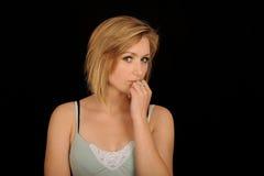 Pretty blond adolescent. A studio portrait of a pretty blond teenage girl or adolescent.  Black background Stock Images
