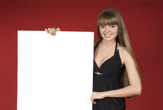 Pretty blond with advertising sheet Stock Photography