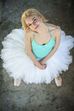 Pretty blond ballerina looking up at the camera Royalty Free Stock Photo