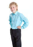 Pretty blond boy wearing blue shirt looking at camera, isolated white background Stock Photo