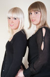 Pretty blond and brunette girls Stock Image