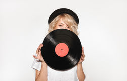 Pretty blond closing face with vinyl stock photo