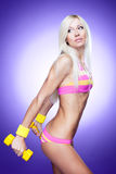 Pretty blond doing aerobics Stock Photo