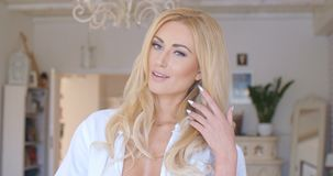 Pretty Blond Female Showing her Cleavage. Close up Pretty Young Blond Female in White Shirt Showing her Cleavage Sensually In Front of the Camera Royalty Free Stock Photo