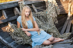 Pretty blond in a fishing boat Royalty Free Stock Photo