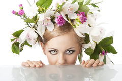 Pretty blond with flower crown on head, she is beh Royalty Free Stock Photography