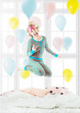Pretty blond fooling around delight jumping on the bed Royalty Free Stock Photos