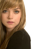 Pretty blond girl. Close-up of a pretty young woman stock photography