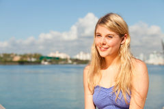 Pretty blond girl by the bay Stock Photography