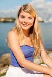 Pretty blond girl by the bay Stock Image