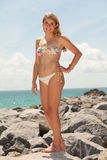 Pretty blond girl at the beach Royalty Free Stock Image