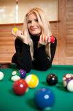 Pretty blond girl with billiard balls Royalty Free Stock Image