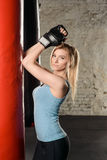 Pretty blond girl in boxing gloves. Stock Photos