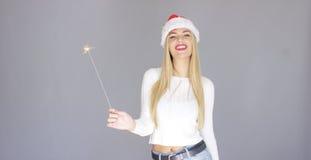 Pretty blond girl enjoy chrismas with sparkler Stock Photography