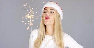 Pretty blond girl enjoy chrismas with sparkler Royalty Free Stock Photos