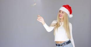 Pretty blond girl enjoy chrismas with sparkler Stock Photo