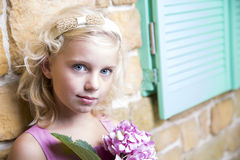 Pretty blond girl with flowers Stock Image
