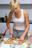 Pretty Blond Girl In The Kitchen Making Pasta Royalty Free Stock Image