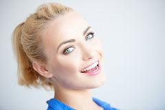 Pretty blond girl laughing at the camera stock images