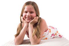 Pretty blond girl lying on a couch Royalty Free Stock Image