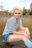 Pretty blond girl outdoors Stock Photography