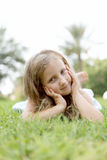 Pretty blond girl outdoors Stock Images