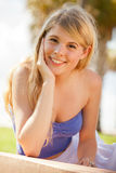 Pretty blond girl at a park Stock Photography