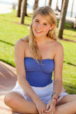 Pretty blond girl at a park Royalty Free Stock Image